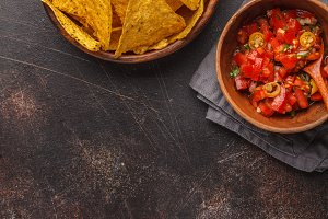 Nachos chips with tomato sauce