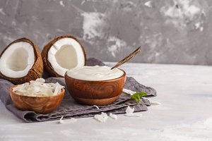 Coconut yogurt in wooden bowl