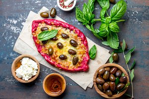 Healthy beetroot pizza with feta and olives. Homemade beetroot pizza