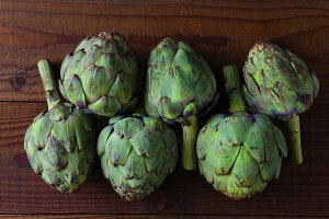 Fresh picked artichokes on wood tabl