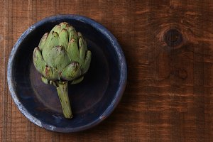 Artichoke on Blue Plate