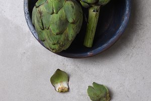 Two Artichokes on Blue Plate