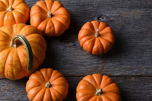Pumpkins on a Rustic Wood Table