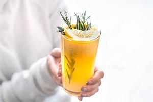 girl holding orange juice