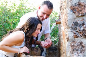 Young couple drinking in a fountain2