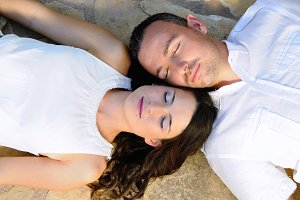 Couple lying with eyes closed