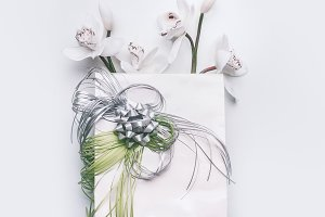 Gift bag with ribbons and orchid