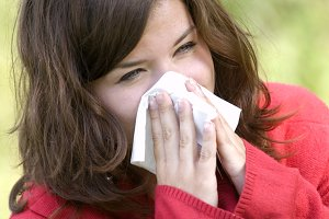 Pretty woman sneeze