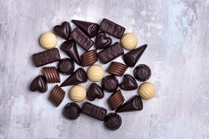 various chocolate pralines isolated on stone background