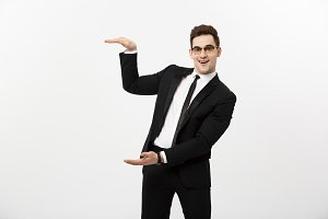 Business Concept - Handsome young business man happy smile, businessman showing something on the open palm, concept of advertisement product isolated over white background