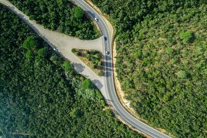 Aerial views of roads with curves