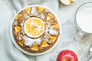 orange pie with cup of kefir