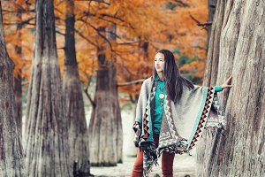Fashionable woman walking in autumn.