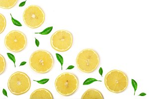Slices lemon decorated with green leaves isolated on white background with copy space for your text. Flat lay, top view