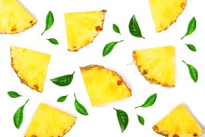 Sliced pineapple decorated with leaves isolated on white background. Top view. Flat lay pattern