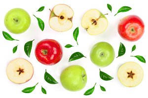 red and green apples with slices decorated with green leaves isolated on white background top view. Flat lay pattern