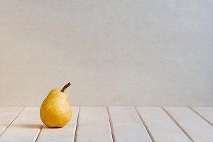 Pear on the white table