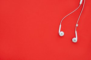 Music earphones red background