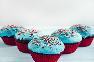 Festive cupcakes with turquoise glaz