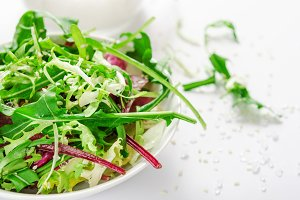 Salad from fresh arugula, lettuce