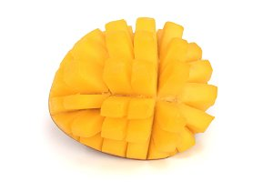 Mango fruit half isolated on white background close-up