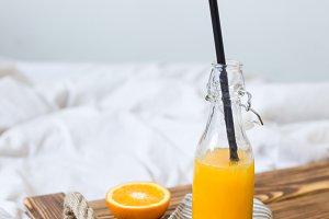 Fresh orange juice on a tray.