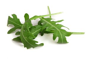 Green fresh rucola or arugula leaf isolated on white background