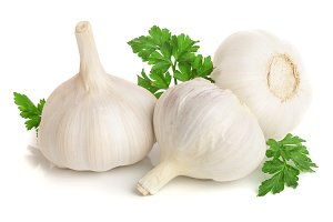 garlic with parsley leaf isolated on white background