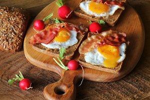 Breakfast , crispy bacon, fried eggs