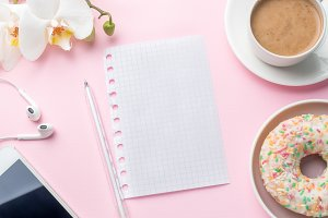 Flat lay Coffee Cup Donut Orchid Notepad Pencil Player Vanilla on a Pink background