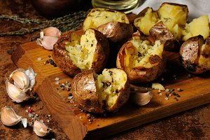 baked potato with spices and herbs
