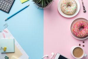 Flat lay Coffee Cup Donut Cactus Notepad Pencil Watch Player Vanilla on a Pink Blue background