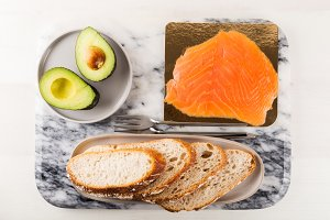 Healthy Snack with Wholemeal Bread Toasts, Avocado and Salmon