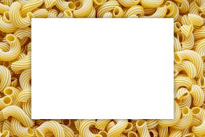 rigati macaroni background. White space for text and ideas.
