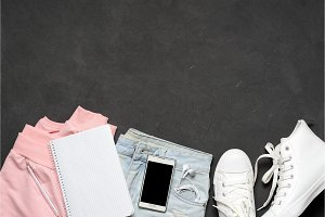 Fashion woman casual clothes Set. Black White. Pink blouse, blue jeans, white sneakers, tablet, phone