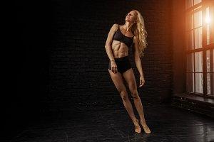 Beautiful sporty lady in black