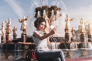 Black girl in front of fountain