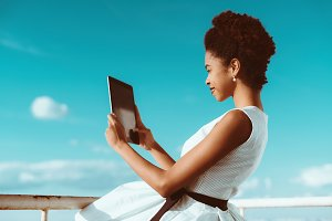 Black girl with the tablet pc