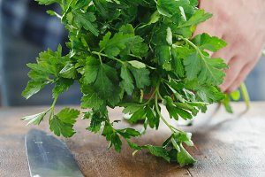Male hands holding fresh parsley
