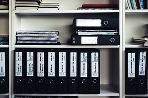 Shelf with documents in office