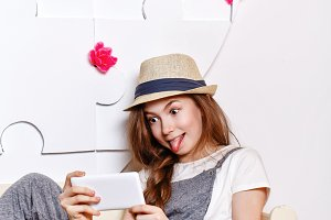 Cheerful teen girl with a cell phone