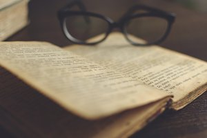 Glasses on a old book 1