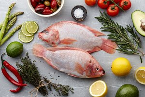 Raw red tilapia fish cooking