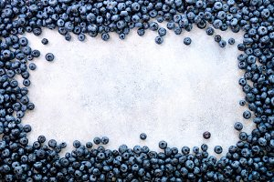 Texture of blueberry berries close up. Border design. Fresh blueberries background with copy space for your text. Vegan, vegetarian concept. Summer healthy food