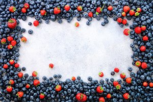 Food frame with mix of strawberry, blueberry. Top view. Vegan and vegetarian concept. Summer berries background