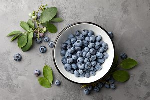 Fresh ripe blueberries with leaves