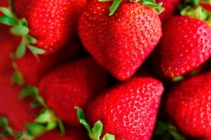Organic strawberries background with copy space. Top view. Vegan and vegetarian concept. Berries texture. Summer healthy food. Macro of strawberry