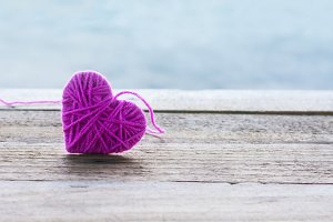 pink knitting wool in shape of heart