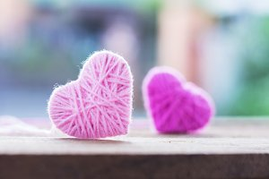 Pink knitting wool shape of heart