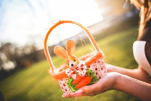 Girl Holding Basket with Easter Eggs